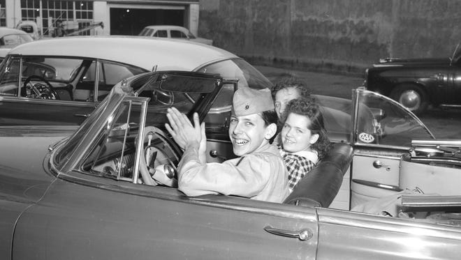 """Marine Pfc Edward X. Susalla was standing in an airline ticket office in the Peabody on 2 Apr 1954 when his mother and sister walked up behind him.  The dark-haired marine had planned to fly home to St. Clair Shores, Michigan for his first auto, an 18th birthday present.  Mrs. M.V. Susalla and 11-year-old Theresa gave their hero a dramatic surprise by driving down in the auto.  Private Susalla fell immediately in love with the birthday present.  After a quick inspection, the young marine pushed a button that lowered the top.  Rubbing his hands gleefully, he uttered """"Boy, oh boy,"""" before the top came back up and the happy threesome drove away."""