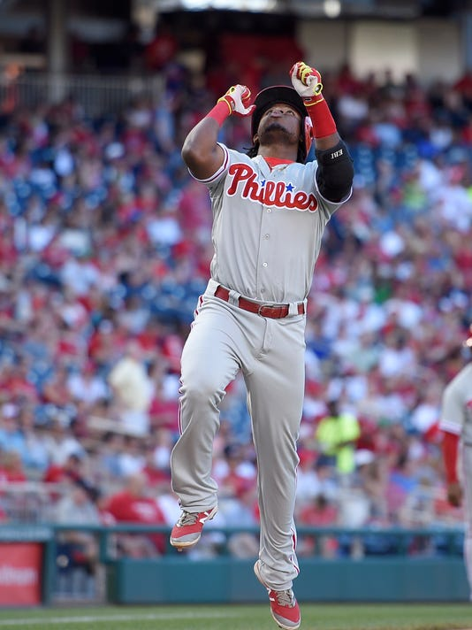 Philadelphia Phillies' Maikel Franco jumps and celebrates as he heads home after he hit a home run during the ninth inning of a baseball game against the Washington Nationals, Sunday, June 12, 2016, in Washington. (AP Photo/Nick Wass)