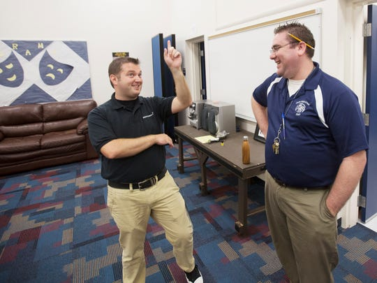 Matthew Murrell, band teacher, left, and Michael Lynch, theater teacher at Paul Laurence Dunbar Middle School have grown their programs to heights no one expected.  They attribute much of that success to a great working relationship.