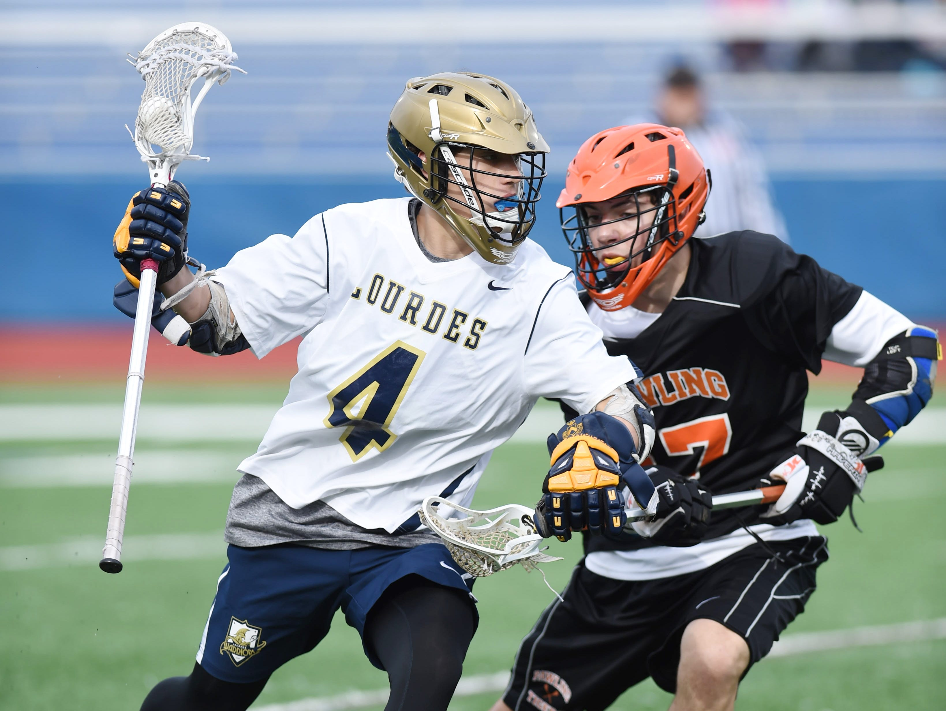 Lourdes' Trevor Arnone fights to get past Pawling's Nick Merendino during Thursday's game at Lourdes.