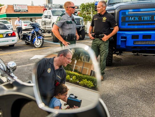 Sergeant Michael Herman of Naples Police shows his