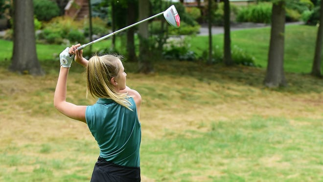 Emily Pierce tees off at Barrington Golf Club during a match last season. The Aurora golf team finished fourth in the Suburban League American Conference standings in 2019.