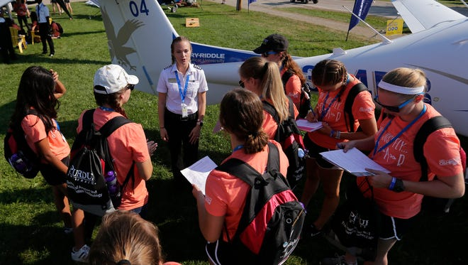 Pilot Hannah Rooney of Embry-Riddle Aeronautical University in Daytona Beach, Florida, talks with prospective candidates,Tuesday, July 24, 2018, at EAA AirVenture 2018 in Oshkosh.