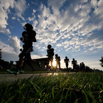 Wauwatosa West Football Players jog off the field after warm ups before the start of the teams game against Grafton at Wauwatosa West High School Friday, Aug. 26, 2016, in Wauwatosa, Wisconsin.
