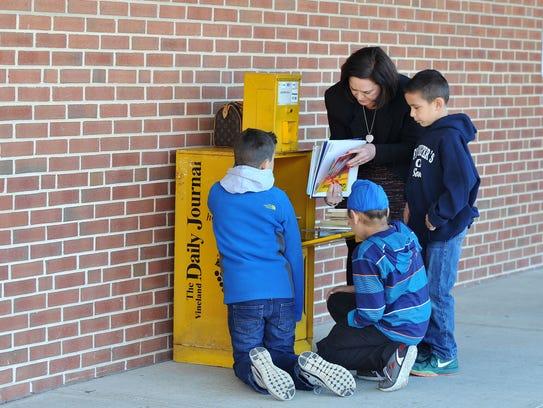 Milanesi School principal Anna Bettini browses Little