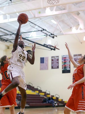Licking Heights junior Jordin Spears goes up for a layup against Heath during a January game. Spears was named the Licking County League-Buckeye Division Player of the Year in February.