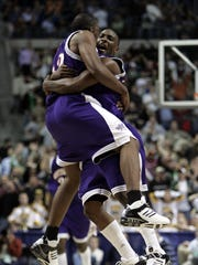 Northwestern State's Jermaine Wallace, back to camera, and Luke Rogers celebrate moments after Wallace hit the winning shot in the Demons' 2006 NCAA Tournament game against Iowa.