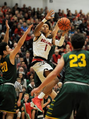 New Albany's Romeo Langford (1) is fouled as he tries to shoot against Floyd Central on Friday at New Albany High School. (Photo by David Lee Hartlage, Special to The Courier-Journal) Dec. 9, 2016