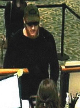 A surveillance photo of the suspect in a robbery of the First National Bank on Lincoln Avenue in Loveland on Wednesday.
