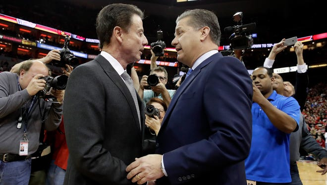 LOUISVILLE, KY - DECEMBER 21:  Rick Pitino the head coach of the Louisville Cardinals and John Calipari the head coach of the Kentucky Wildcats talk before the game at KFC YUM! Center on December 21, 2016 in Louisville, Kentucky.  (Photo by Andy Lyons/Getty Images)