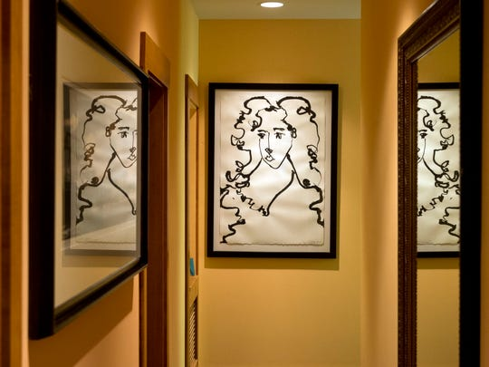 The drawing at the end of the hallway to the master suite is by Richard Jolley.