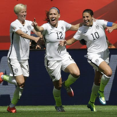 From left, United States' Megan Rapinoe, Lauren Holiday, and Carli Lloyd celebrate after Lloyd scored her second goal of the match against Japan during the first half of the FIFA Women's World Cup soccer championship in Vancouver, British Columbia, Canada, Sunday, July 5, 2015.