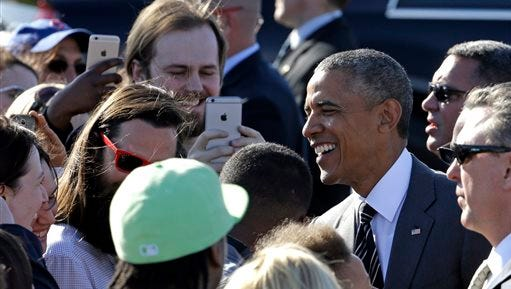 President Barack Obama smiles as he greets people in Portland, Ore., Thursday, May 7, 2015. On Friday, the president will visit Nike headquarters in Beaverton, Ore., to make his trade policy pitch as he struggles to win over Democrats for what could be the last major legislative push of his presidency. (AP Photo/Don Ryan)