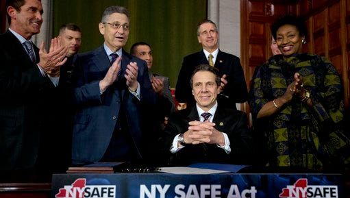 New York Gov. Andrew Cuomo and legislative leaders applaud after Cuomo signed New York's Secure Ammunition and Firearms Enforcement Act into law during a ceremony in the Red Room at the Capitol on Tuesday, Jan. 15, 2013, in Albany, N.Y.