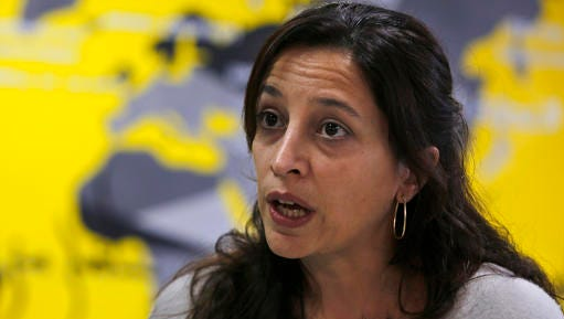 """Lynn Maalouf, deputy director of research at Amnesty International Middle East and North Africa, speaks during an interview with The Associated Press in Beirut, Lebanon, Monday, Feb. 6, 2017. Amnesty International says Syrian authorities killed at least 13,000 people in mass hangings at a prison north of Damascus known to detainees as the """"slaughterhouse."""" The group released a report covering the period from the start of the 2011 uprising until 2015, during which Amnesty says groups of 20 to 50 people were hanged at Saydnaya Prison, once or twice a week, in killings authorized by senior officials, including deputies of President Bashar Assad."""