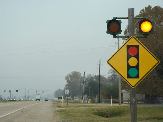 Flashing lights warn drivers as they approach the traffic