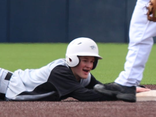 Diving safely back to second base Saturday at Ray Fisher Stadium is Plymouth's Pete Carravallah.