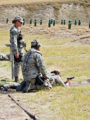 Airmen from the 120th Security Forces Squadron conduct weapons training at Fort Harrison on Tuesday.