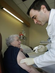 Thelma Imm, 77, from Cleveland receives a shot from