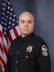 Officer Brad Shouse, a member of the Louisville Metro