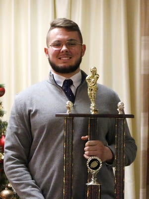 Elmira senior Dan Fedor holds the Ernie Davis Award trophy on Thursday during a ceremony at the Elmira Holiday Inn-Riverview.