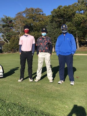 East Bridgewater's (from left) Jake Redder, Cole Redder and Justin Robinson pose for a photo after winning the South Shore League Cup on Wednesday, Nov. 4, 2020 at Cohasset Golf Club.