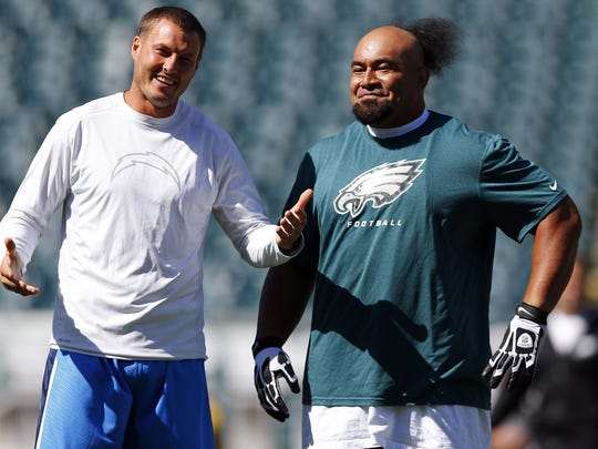 Former Eagles NT Isaac Sopoaga, right, has joined Chargers QB Philip Rivers in the AFC.