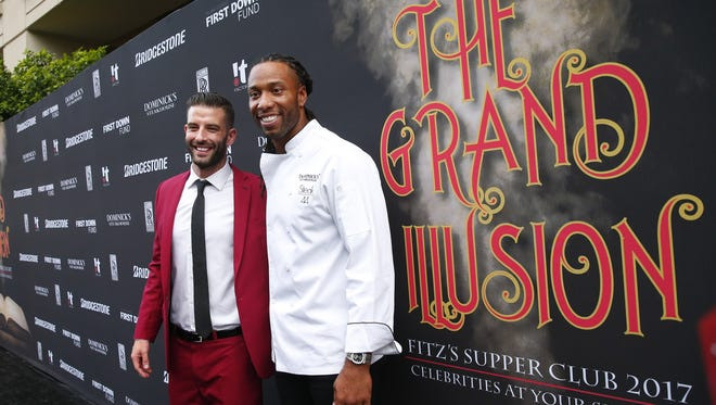 Illusionist Darcy Oake and Cardinals receiver Larry Fitzgerald stand on the red carpet at Dominick's Steakhouse in Scottsdale Ariz. August 29, 2017. The 9th Annual Fitz's Supper Club raises money for the Larry Fitzgerald First Down Fund, which supports kids and families.