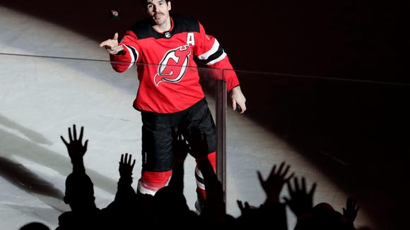 New Jersey Devils center Brian Boyle throws a puck bf8fa0044