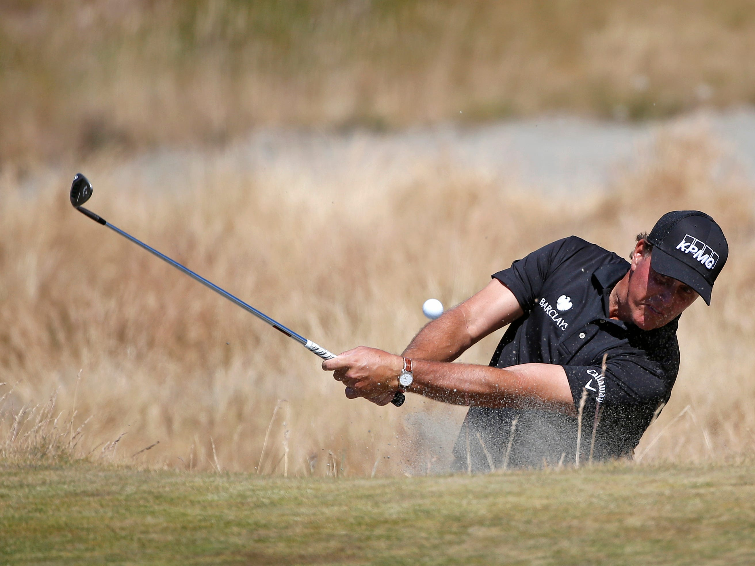 Phil Mickelson hits out of the bunker on the 15th hole during the second round of the U.S. Open golf tournament at Chambers Bay on Friday, June 19, 2015 in University Place, Wash. (AP Photo/Lenny Ignelzi)