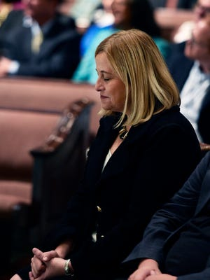 Mayor-elect Megan Barry bows her head during a prayer at an interfaith prayer service for her and other elected officials at Watson Grove Missionary Baptist Church on Friday, Sept. 25, 2015.