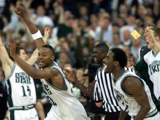 Joy: Morris Peterson and Mateen Cleaves lead their teammates off the bench in a celebration of Michigan State University's NCAA Championship win over Florida in April 2000. The Spartans beat the Gators 89-76 in Indianapolis.