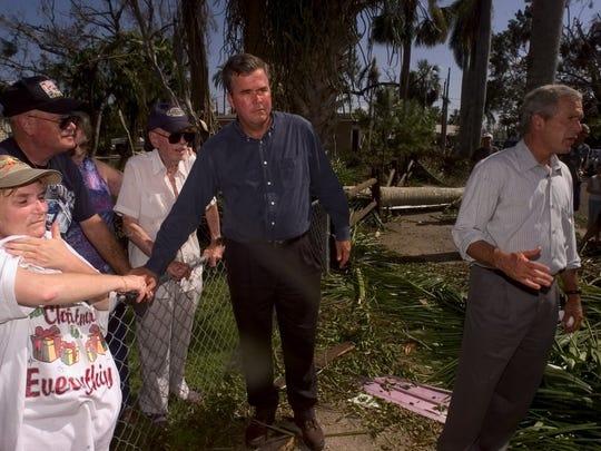 President George W. Bush and  Gov. Jeb Bush  visit with Punta Gorda residents in 2004 following Hurricane Charley.