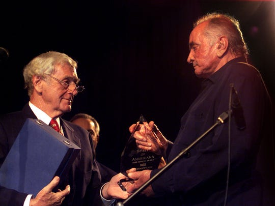 Country music legend Johnny Cash receives the Spirit of Americana Free Speech Award from John Seigenthaler during the 2002 Americana Music Awards show in Nashville.