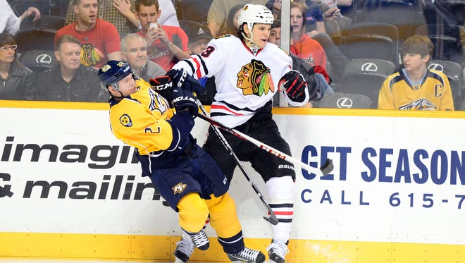 Blackhawks left wing Daniel Carcillo, right, collides with the Predators' Patric Hornqvist in a 2013 game in Nashville.