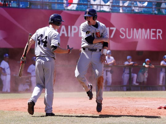 Iowa Hawkeyes infielder Chris Whelan (28) celebrates with outfielder Robert Neustrom (44) after doubling to drive in three runs and then scoring in the top of the ninth inning against Korea Saturday, August 26, 2017 in Taipei, Taiwan.