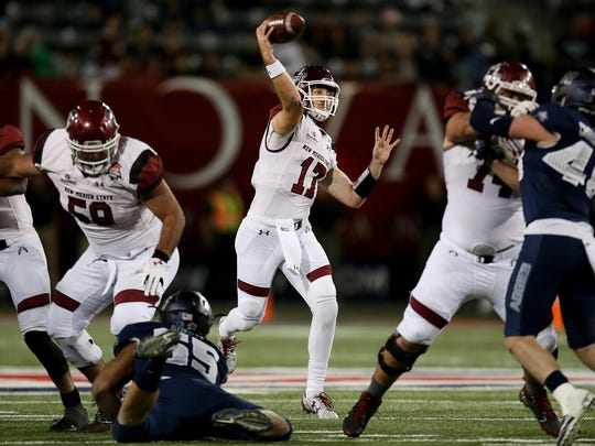 New Mexico State Aggies quarterback Tyler Rogers (17) fires a pass during the fourth quarter between Utah State University and New Mexico State University in the NOVA Home Loans Arizona Bowl on Dec. 29, 2017, at Arizona Stadium in Tucson, Ariz. New Mexico State won 26-20 in overtime.