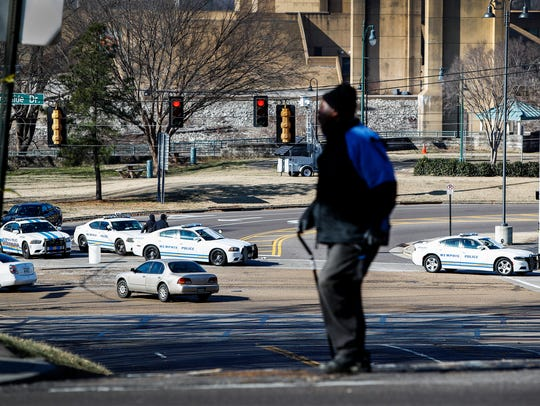 January 06, 2018 - Police block traffic to the visitors Center downtown as they prepared for protesters to possibly parade through the city in 18-wheelers, cars and motorcycles to demonstrate against the recent removal of Confederate monuments.