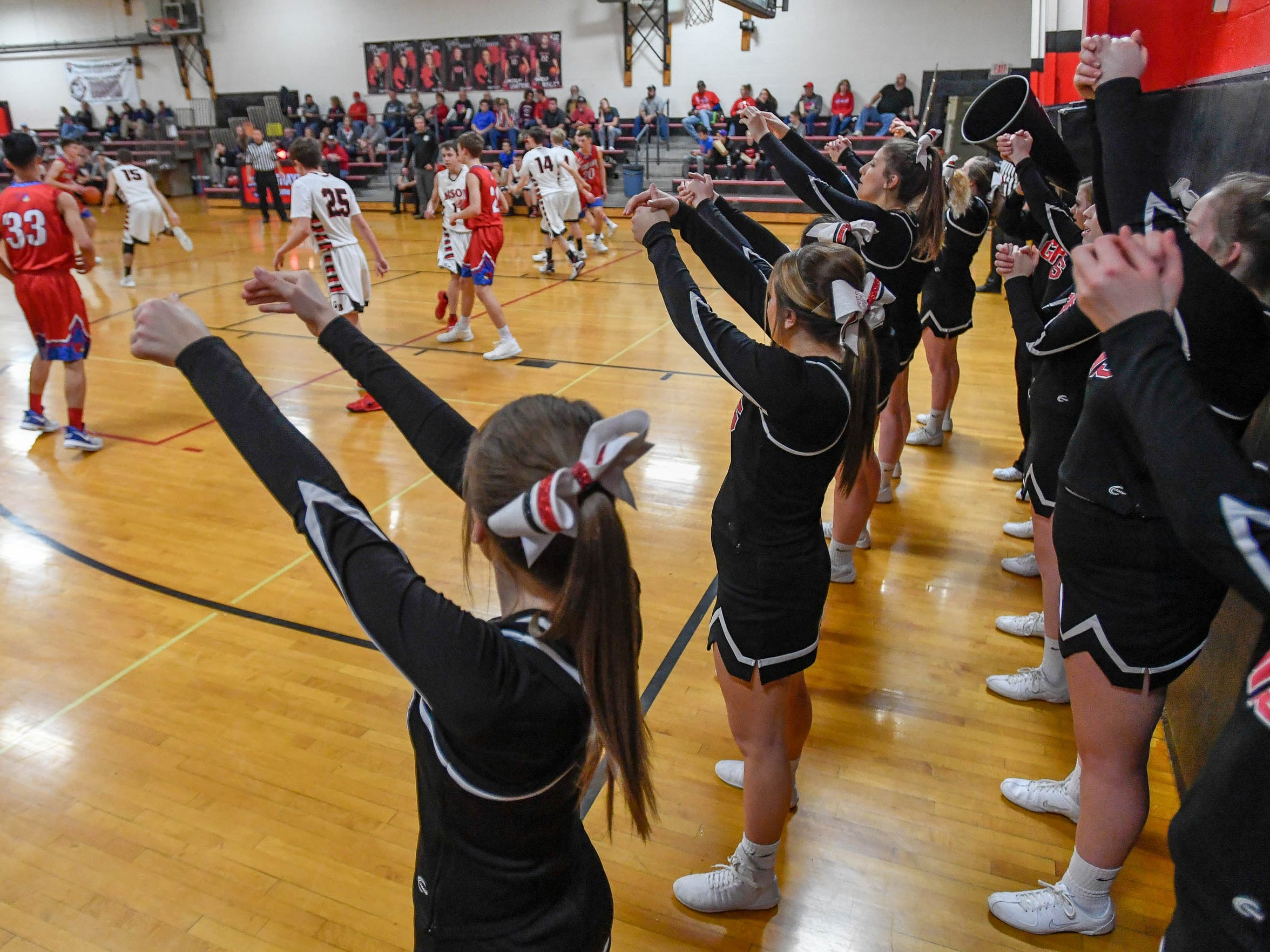 The Grayville Bison cheerleaders lead a cheer during