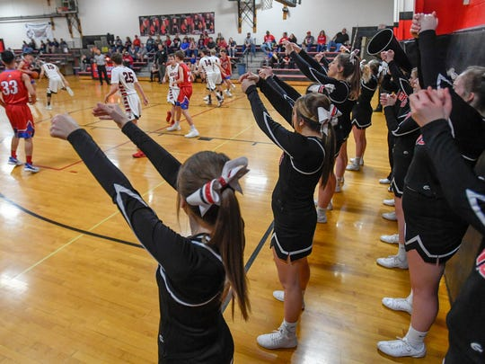 The Grayville Bison cheerleaders lead a cheer during the Grayville game with the Woodlawn Cardinals in Grayville Tuesday, January 23, 2018.