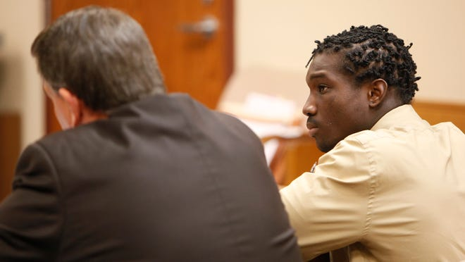 Larvern Hale sits at the defendant's table during a preliminary hearing on Friday. He is charged with bringing  a gun into Central High School.