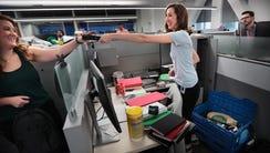 Lindsay Martin, center, unpacks at ServiceMaster's