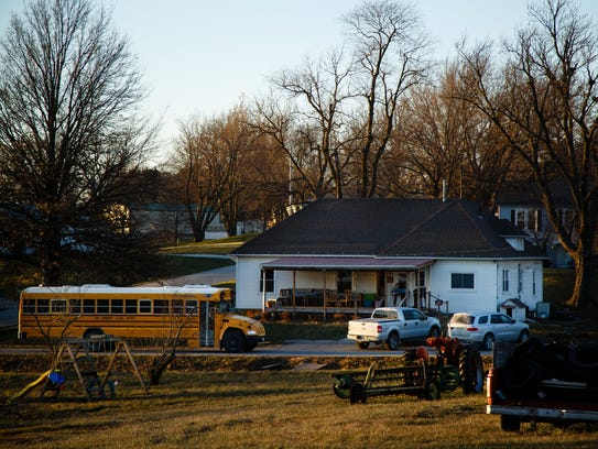 A school bus drops off Bailey Lillard, 9, and her brother