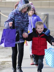 Autumn Klepach, 10, and Gage Ebert, rush with their