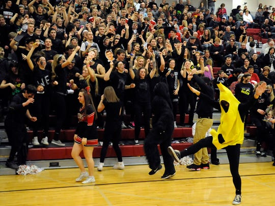"The Fairfield Union student section ""goes bananas"" during a time out Friday, Jan. 30, during Fairfield Union's game against Hamilton Township at Fairfield Union High School. Fairfield Union was named a finalist for Battle of the Fans."