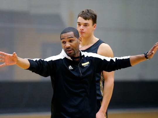 UWM head coach Lavall Jordan instructs during practice for the 2016-17 season at the UWM men's and women's basketball media day.
