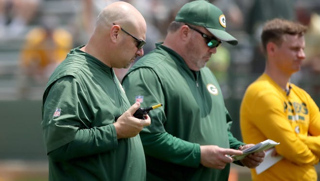 Head coach Mike McCarthy and defensive coordinator  Mike Pettine during Green Bay Packers minicamp at Ray Nitschke Field Tuesday, June 12, 2018 in Ashwaubenon, Wis.
