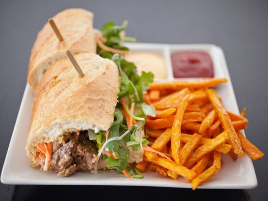 Near Surprise Stadium: At Saigon Kitchen in Surprise are menu items like this barbecue-pork bahn mi sandwich.
