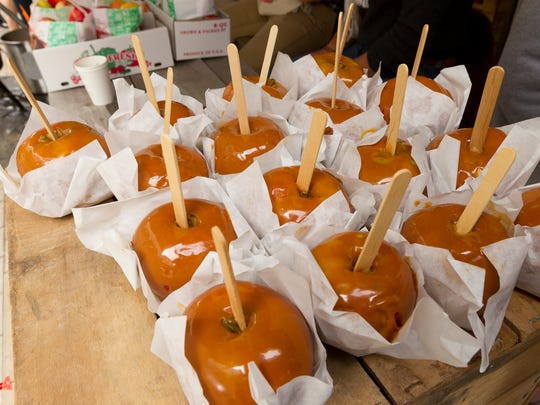 Caramel apples for sale at the Indian Creek Farm stand Friday at the Apple Harvest Festival on the Commons in Ithaca.
