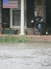 Donald Fontaine sits on his Rebel Circle front porch